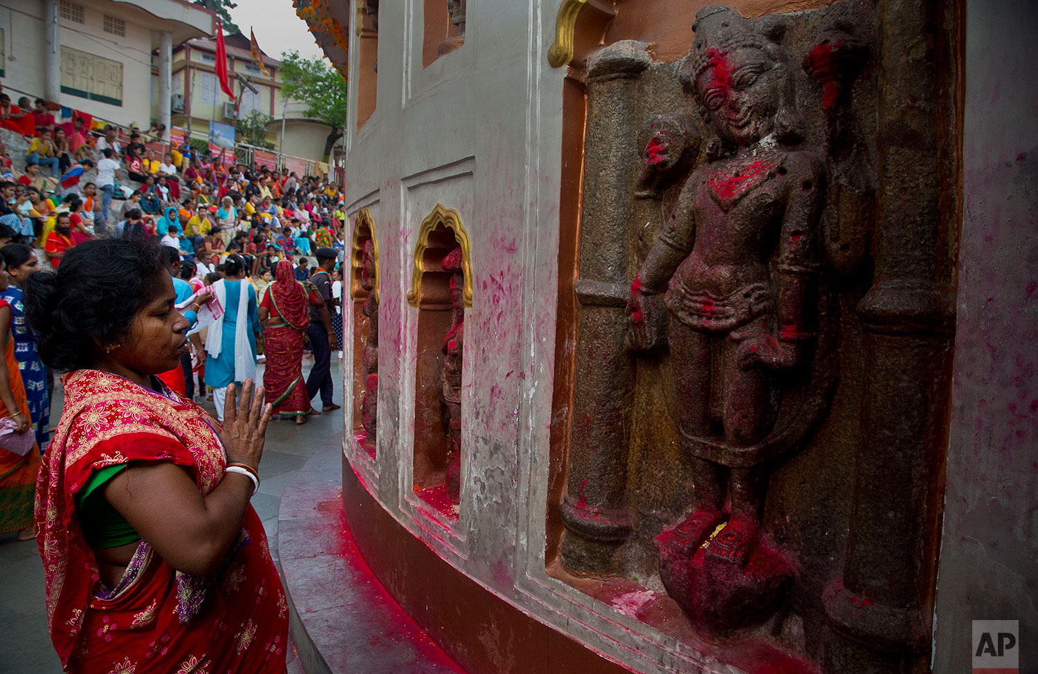 Monika Deb Nath, 45, offers prayers at the Kamakhya temple during the Ambubachi festival in Gauhati, India, June 25, 2019 . Monika, 45, and her husband have visited the Kamakhya temple four years in a row for the annual Ambubachi festival, praying for a miracle to heal their son from cerebral palsy, which has left him with almost no control over his own body. The temple is presided over by the goddess Kamakhya, the most important goddess of tantric worship, an esoteric form of Hinduism.(AP Photo/Anupam Nath)