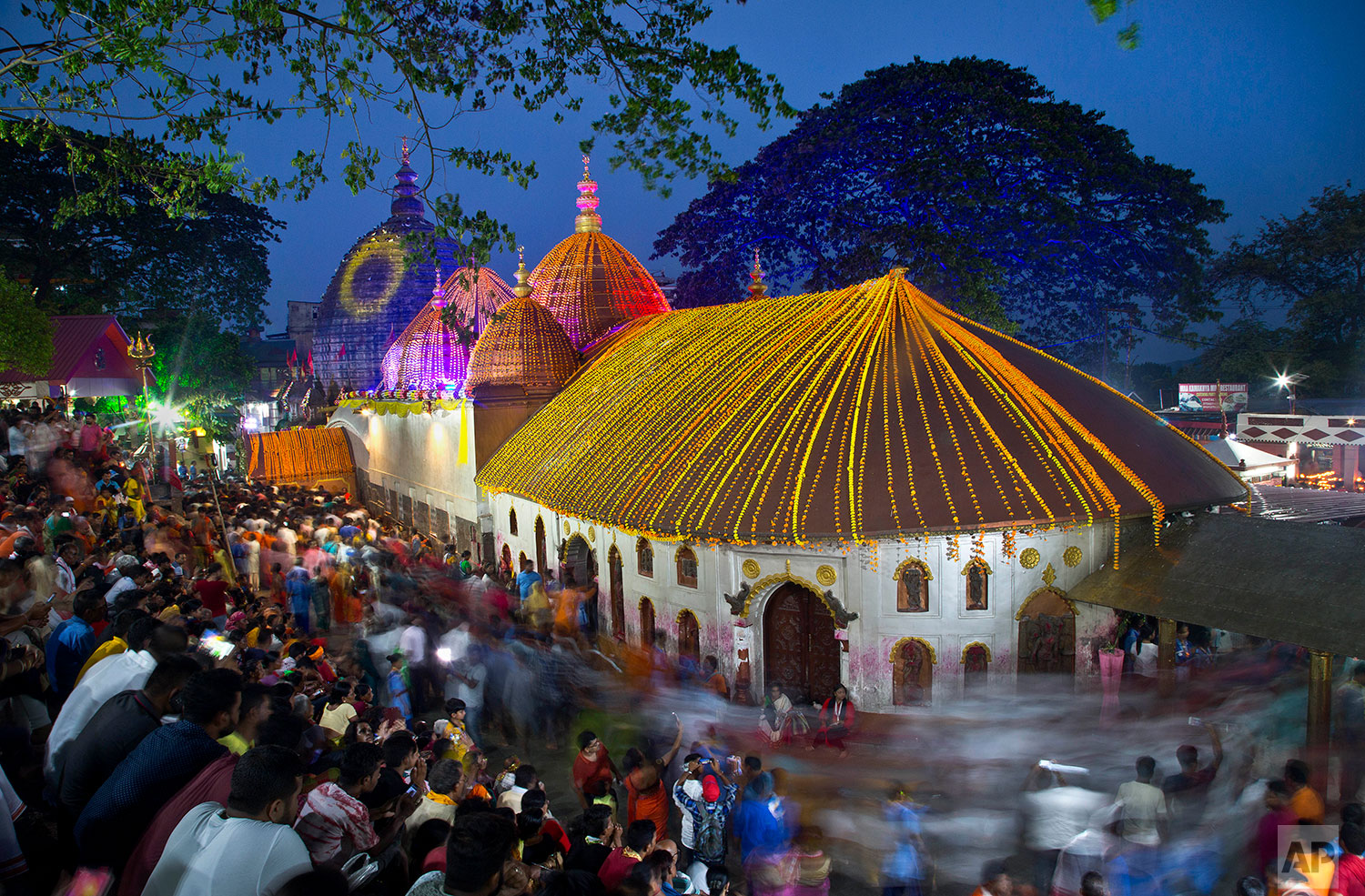 devotees gather at the Kamakhya temple for the Ambubachi festival in Gauhati, India, June 25, 2019 . The temple is presided over by the goddess Kamakhya, the most important goddess of tantric worship, an esoteric form of Hinduism. The four-day Ambubachi festival is a celebration of Kamakhya's yearly menstrual cycle, and it brings hundreds of thousands of devotees to the temple. (AP Photo/Anupam Nath)