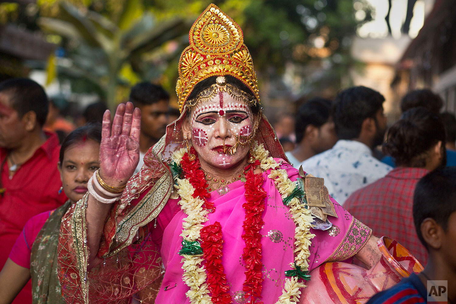 a devotee dressed as goddess Kamakhya attends the Ambubachi festival at the Kamakhya temple in Gauhati, India, June 25, 2019 . The temple is presided over by the goddess Kamakhya, the most important goddess of tantric worship, an esoteric form of Hinduism. The four-day Ambubachi festival is a celebration of Kamakhya's yearly menstrual cycle, and it brings hundreds of thousands of devotees to the temple. (AP Photo/Anupam Nath)