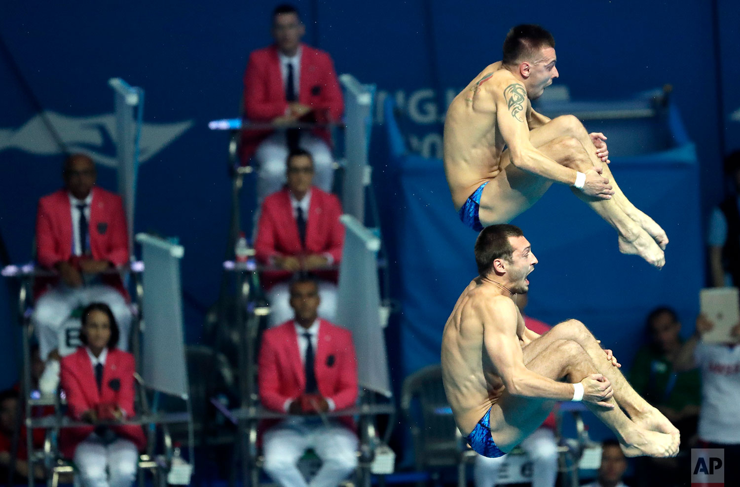 Russia's Aleksandr Bondar and Viktor Minibaev compete in the men's 10m platform synchro diving final at the World Swimming Championships in Gwangju, South Korea, Monday, July 15, 2019. (AP Photo/Lee Jin-man )