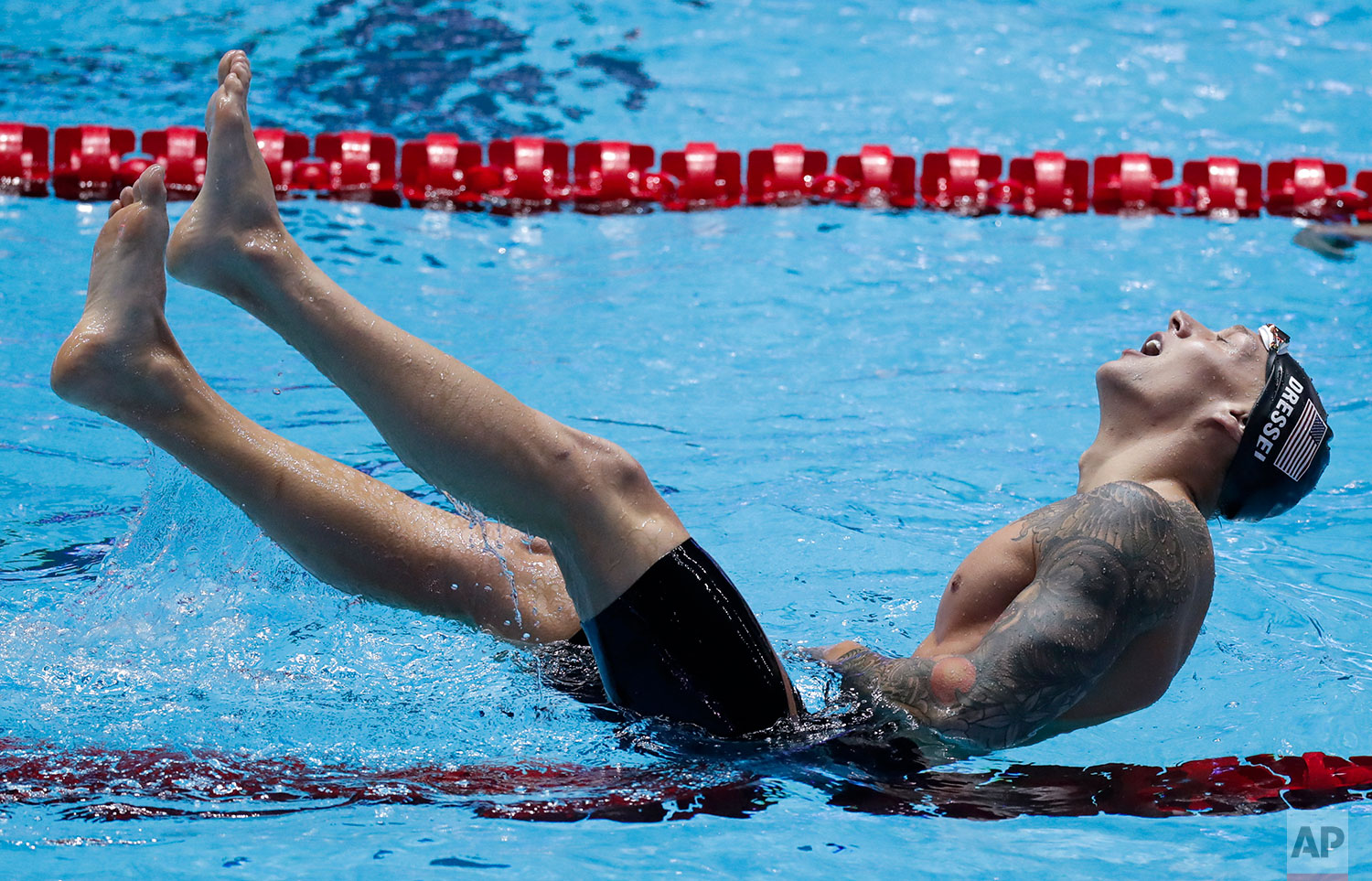 United States' Caeleb Dressel celebrates after winning the men's 100m freestyle final at the World Swimming Championships in Gwangju, South Korea, Thursday, July 25, 2019. (AP Photo/Lee Jin-man)