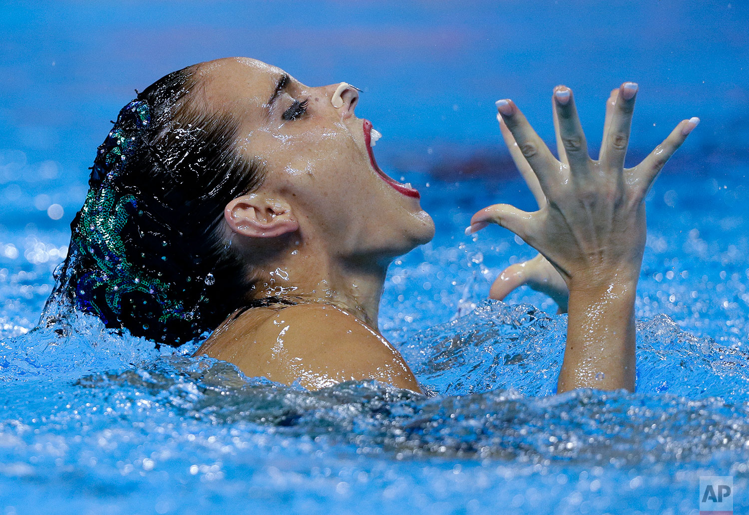 Spain's Ona Carbonell performs her routine in the artistic swimming solo free preliminary at the World Swimming Championships in Gwangju, South Korea, Monday, July 15, 2019. (AP Photo/Mark Baker)