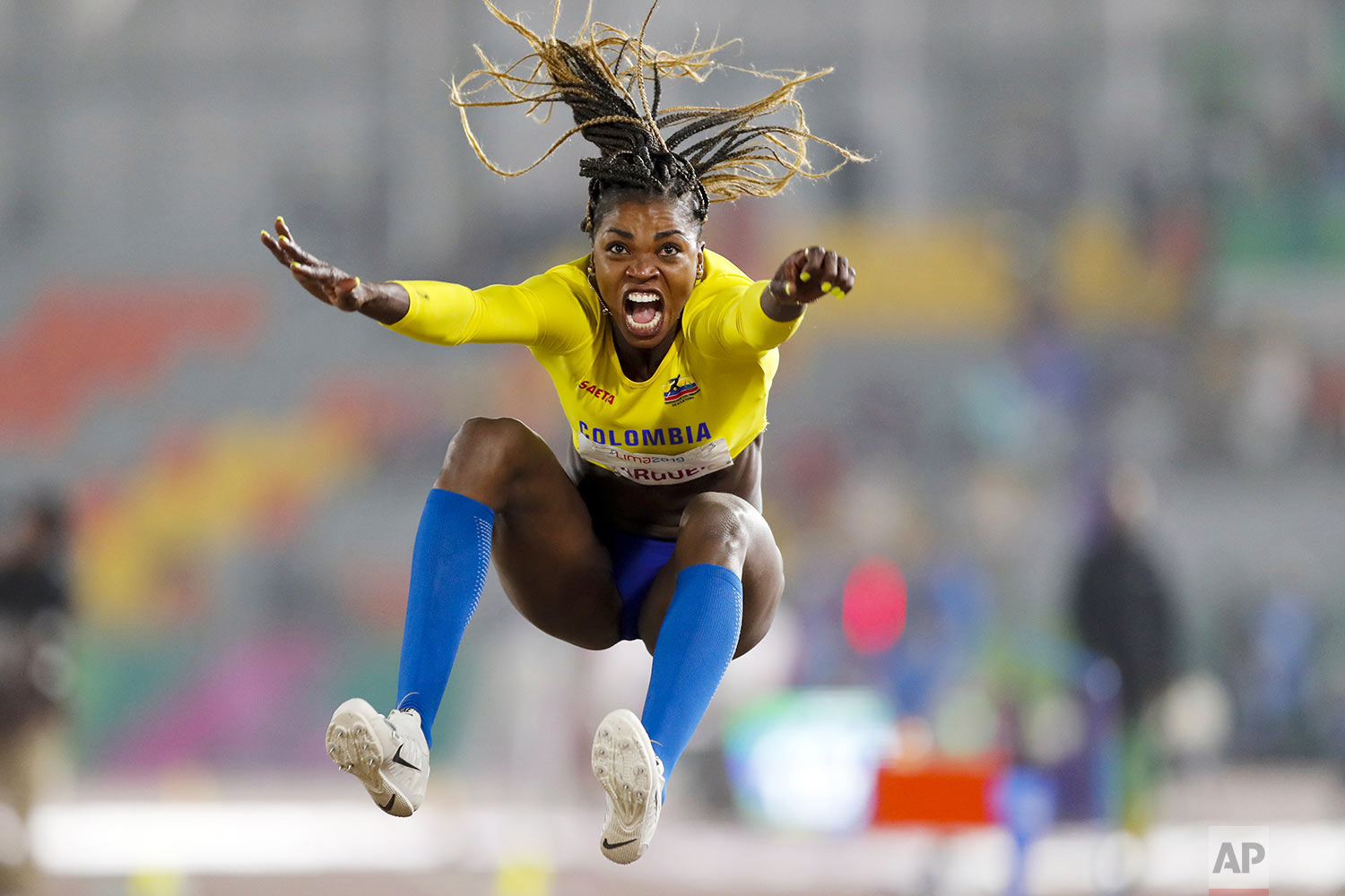 Caterine Ibarguen of Colombia competes in the women's long jump during the athletics at the Pan American Games in Lima, Peru, Tuesday, Aug. 6, 2019. (AP Photo/Fernando Llano)