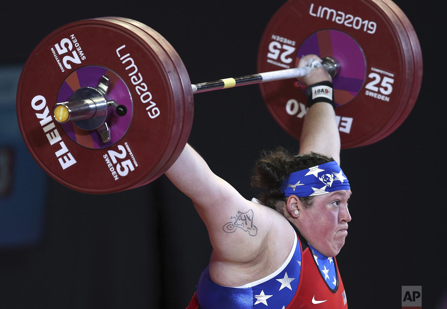 Sarah Robles of the United States competes in women's snatch +87 kg weightlifting at the Pan American Games in Lima, Peru, Tuesday, July 30, 2019. (AP Photo/Martin Mejia)