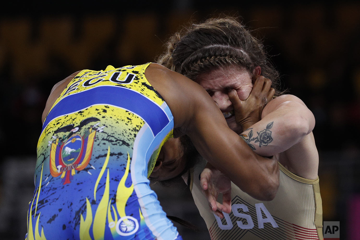 Jenna Burkert of the U.S. gets an eye gouge from Ecuador's Lissette Antes in their women's 57kg freestyle wrestling final bout at the Pan American Games in Lima, Peru, Thursday, Aug. 8, 2019. Antes defeated Burkert to win gold. (AP Photo/Rebecca Blackwell)