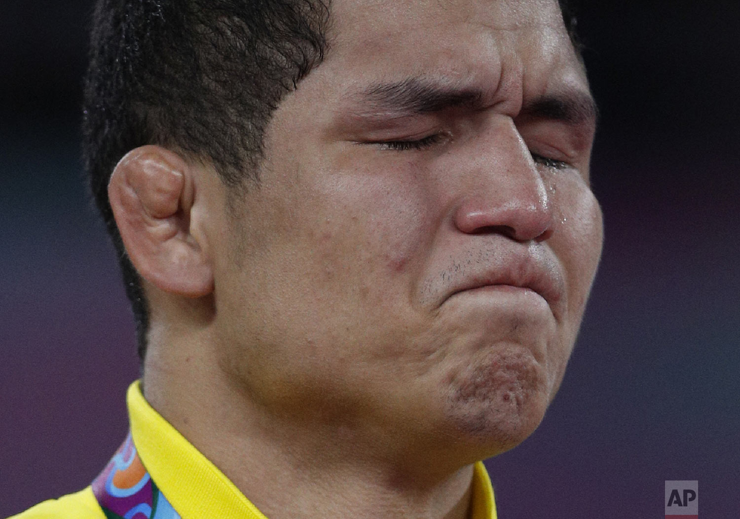 A tear runs down the face of Venezuela's Luis Avendano as he is overcome with emotion after receiving the gold medal for men's 87kg Greco-Roman wrestling at the Pan American Games in Lima, Peru, Wednesday, Aug. 7, 2019. (AP Photo/Rebecca Blackwell)