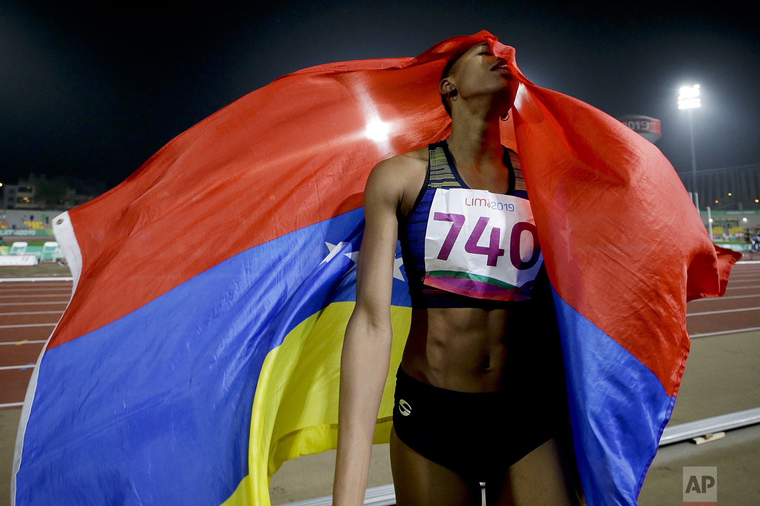 Yulimar Rojas of Venezuela celebrates after winning the gold medal in the women's triple jump final, setting a new Pan American record, during the athletics at the Pan American Games in Lima, Peru, Friday, Aug. 9, 2019. (AP Photo/Fernando Vergara)