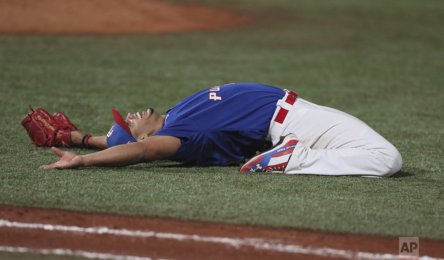Puerto Rico's Fernando Cruz celebrates after saving the win against Canada in the men's baseball gold medal game at the Pan American Games in Lima, Peru, Sunday, Aug. 4, 2019. Puerto Rico won the gold medal. (AP Photo/Fernando Llano)
