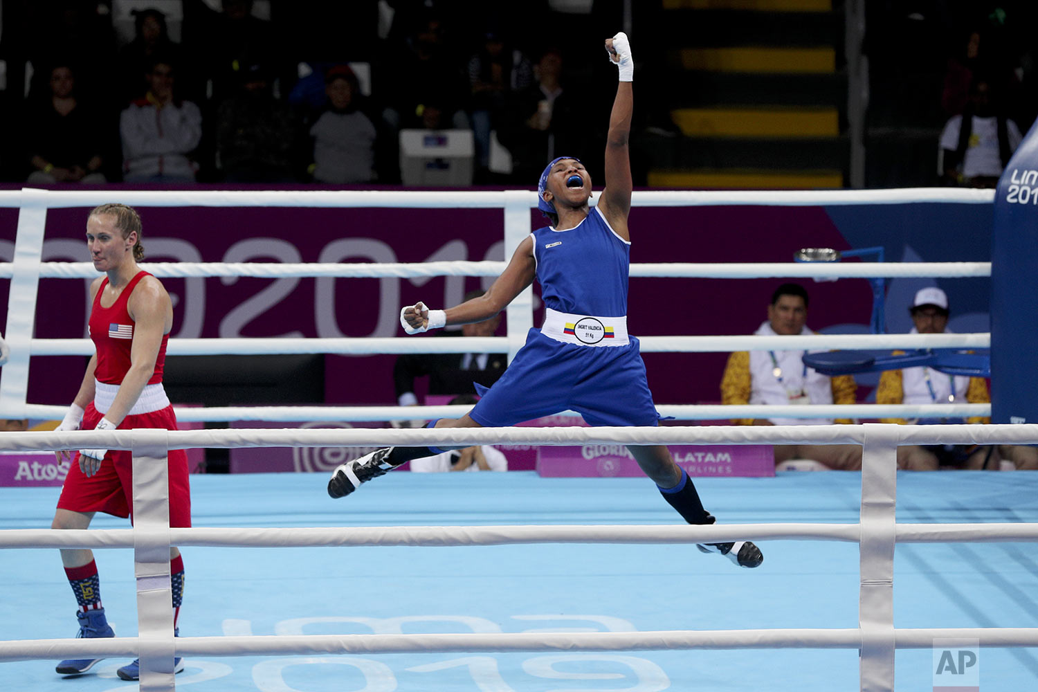 Ingrit Valencia of Colombia celebrates beating Virginia Fuchs of the United States to win the gold medal in their women's flyweight boxing final bout at the Pan American Games in Lima, Peru, Friday, Aug. 2, 2019. (AP Photo/Martin Mejia)