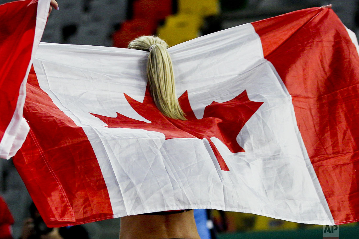 Natasha Wodak of Canada celebrates winning the gold medal in the women's 10000m final during the athletics at the Pan American Games in Lima, Peru, Tuesday, Aug. 6, 2019. (AP Photo/Martin Mejia)