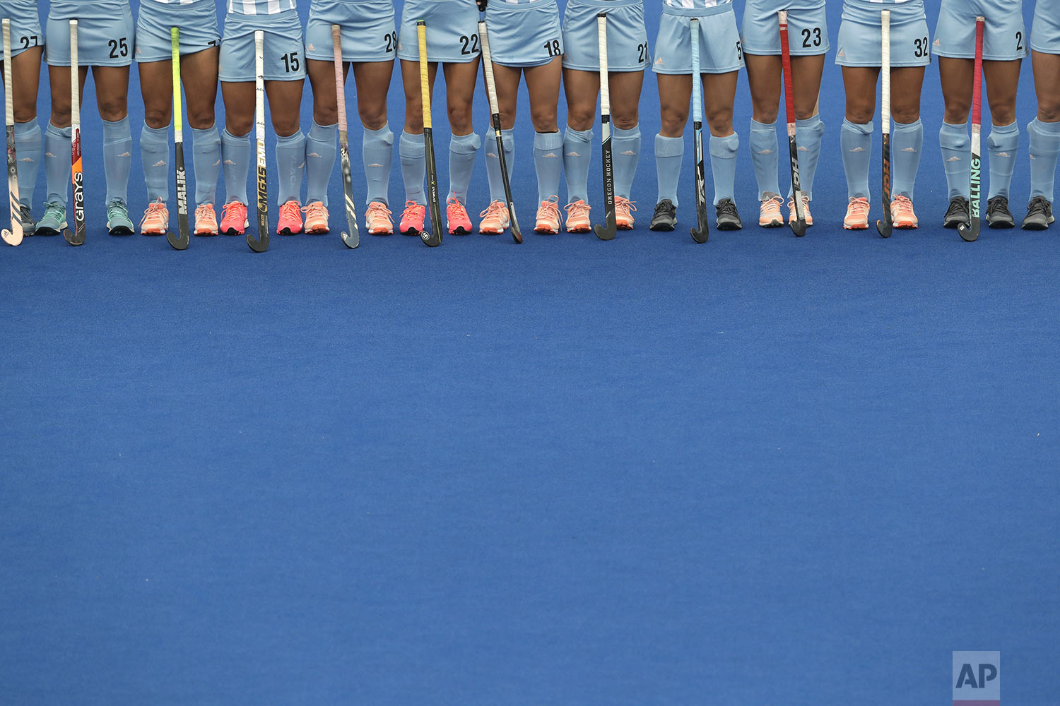 Argentina's hockey players stand in line during the playing of national anthems before their women's preliminaries pool WA against Canada at the Pan American Games in Lima, Peru, Wednesday, July 31, 2019. Argentina won 3-0. (AP Photo/Silvia Izquierdo)
