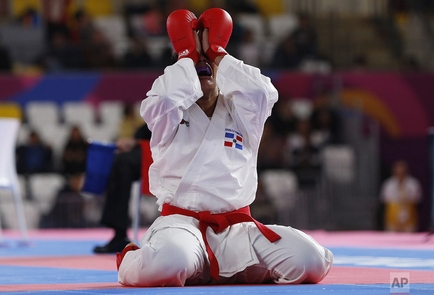 Tanya Rodriguez of the Dominican Republic celebrates after defeating Susana Li of Chile in the women's karate under 68kg gold medal match at the Pan American Games in Lima, Peru, Sunday, Aug. 11, 2019. (AP Photo/Juan Karita)