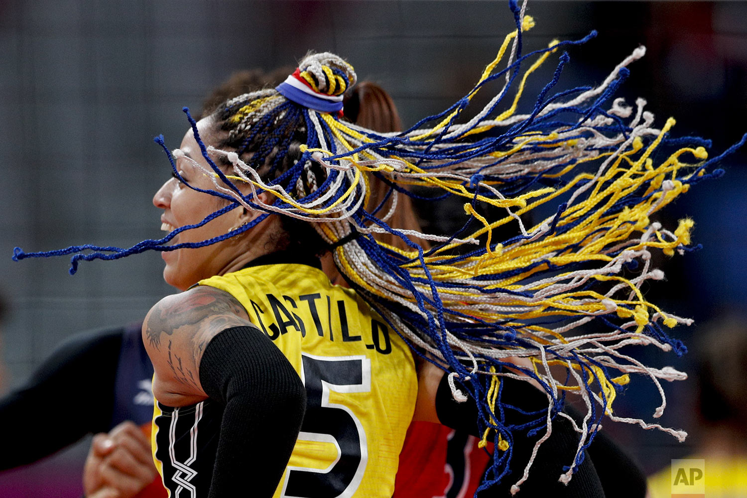 Brenda Castillo of the Dominican Republic jumps during the gold medal women's volleyball match against Colombia at the Pan American Games in Lima, Peru, Sunday, Aug. 11, 2019. (AP Photo/Rebecca Blackwell)