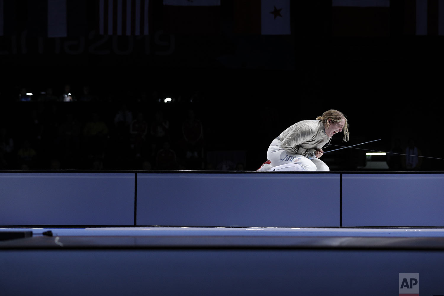 Anne-Elizabeth Stone of the U.S. screams in celebration as she wins the gold medal in her women's sabre individual fencing final bout against Argentina's Maria Perez at the Pan American Games in Lima, Peru, Tuesday, Aug. 6, 2019. (AP Photo/Rebecca Blackwell)