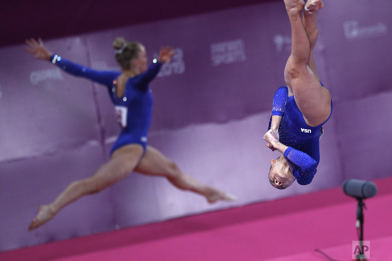 Leanne Wong, right, and Riley McCusker of the U.S. warm up to compete on beam in the women's gymnastics qualification and team final at the Pan American Games in Lima, Peru, Saturday, July 27, 2019. (AP Photo/Rebecca Blackwell)