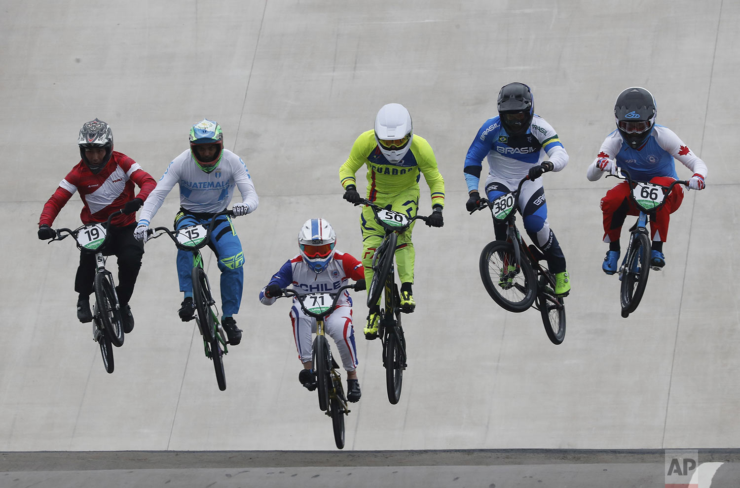 Athletes compete in men's cycling bmx semi-final at the Pan American Games in Lima, Peru, Friday, Aug. 9, 2019. (AP Photo/Fernando Llano)