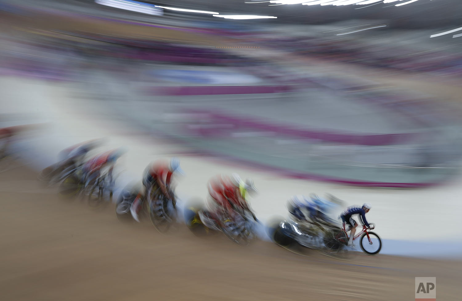 Daniel Holloway of the United States, right, competes in the cycling track men's omnium final at the Pan American Games in Lima, Peru, Thursday, Aug. 1, 2019. Holloway won the gold medal and Prado the silver medal. (AP Photo/Juan Karita)