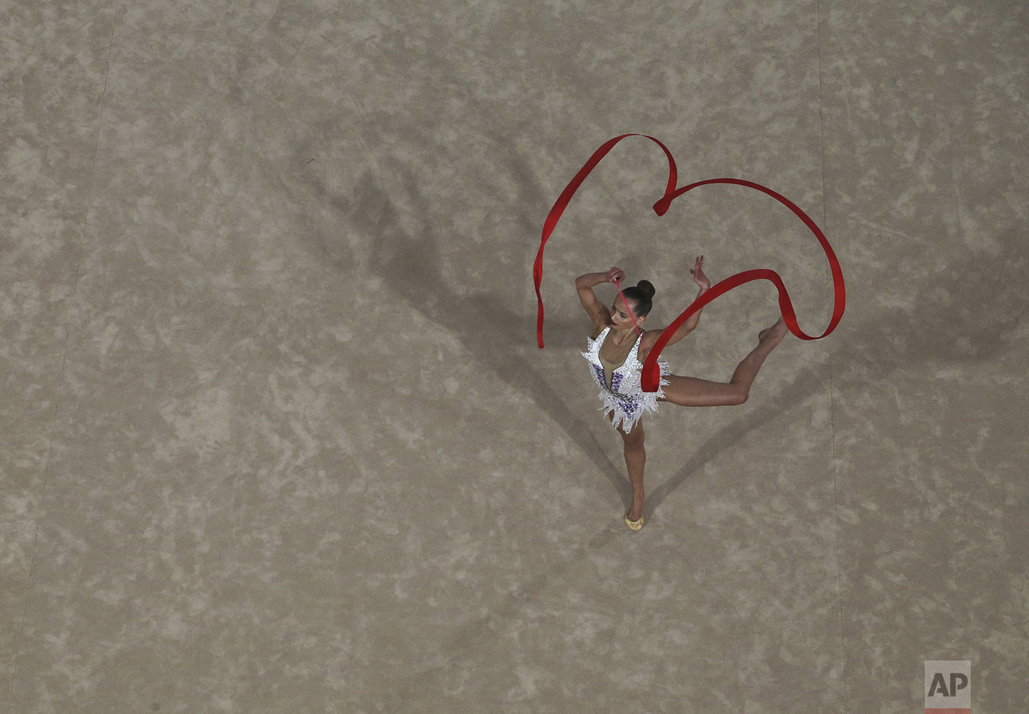 Camila Freeley of United States competes for the silver medal in the rhythmic gymnastics individual all around rotation 3 at the Pan American Games in Lima, Peru, Saturday, Aug. 3, 2019. (AP Photo/Fernando Llano)