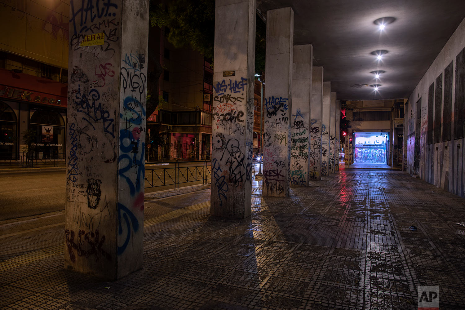 A building and its columns are covered with graffiti in Exarcheia district of Athens, July 25, 2019. (AP Photo/Petros Giannakouris)