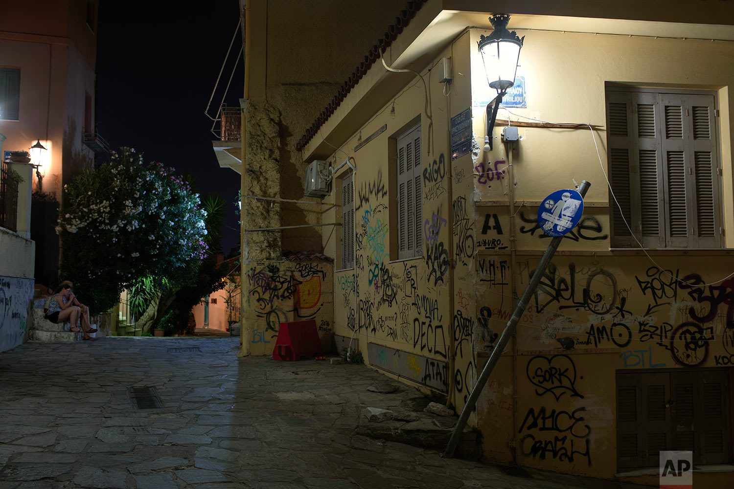 A shop is covered with graffiti in Psiri district , central Athens, July 4, 2019. (AP Photo/Petros Giannakouris)