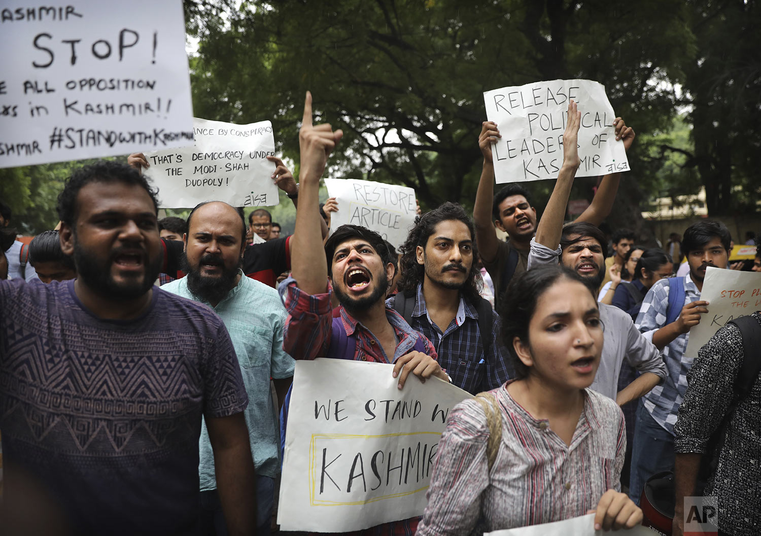 Left party supporters and students shout slogans during a protest against Indian government revoking Kashmir's special constitutional status in New Delhi, India, Monday, Aug. 5, 2019. (AP Photo/Manish Swarup)