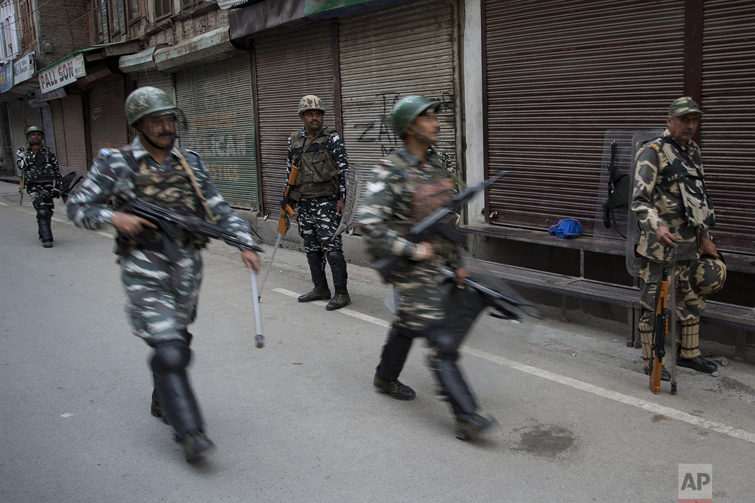 Indian Paramilitary soldiers patrol during curfew in Srinagar, Indian controlled Kashmir, Friday, Aug. 9, 2019. (AP Photo/ Dar Yasin)