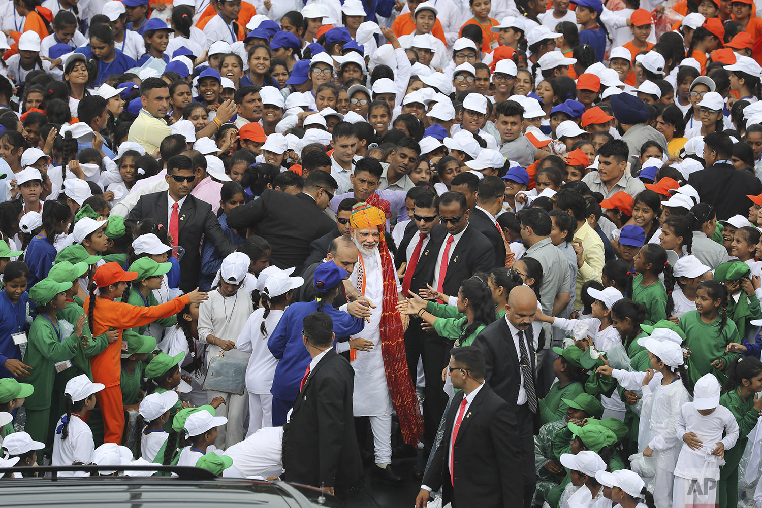 Indian Prime Minister Narendra Modi, center, greets school children after addressing the nation on the country's Independence Day from the ramparts of Mughal-era Red Fort, in New Delhi, India, Thursday, Aug. 15, 2019. (AP Photo/Manish Swarup)