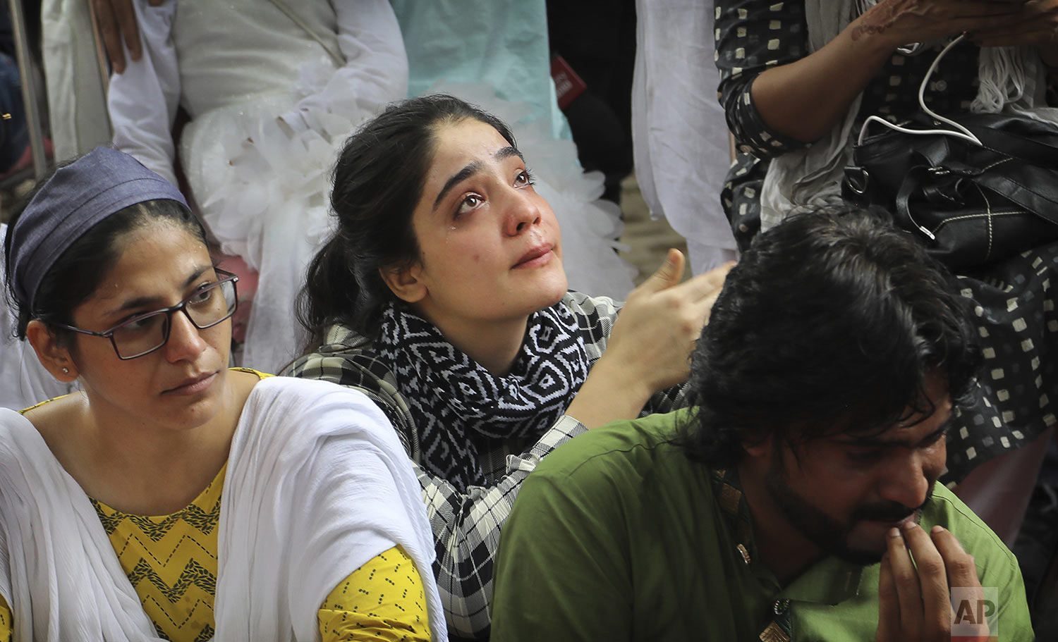 A Kashmiri woman breaks down after listening to a fellow Kashmiri narrating memories of past Eid in the valley as Kashmiris living in New Delhi gather for a function to observe Eid al-Adha away from their homes in New Delhi, India, Monday, Aug. 12, 2019. (AP Photo/Manish Swarup)