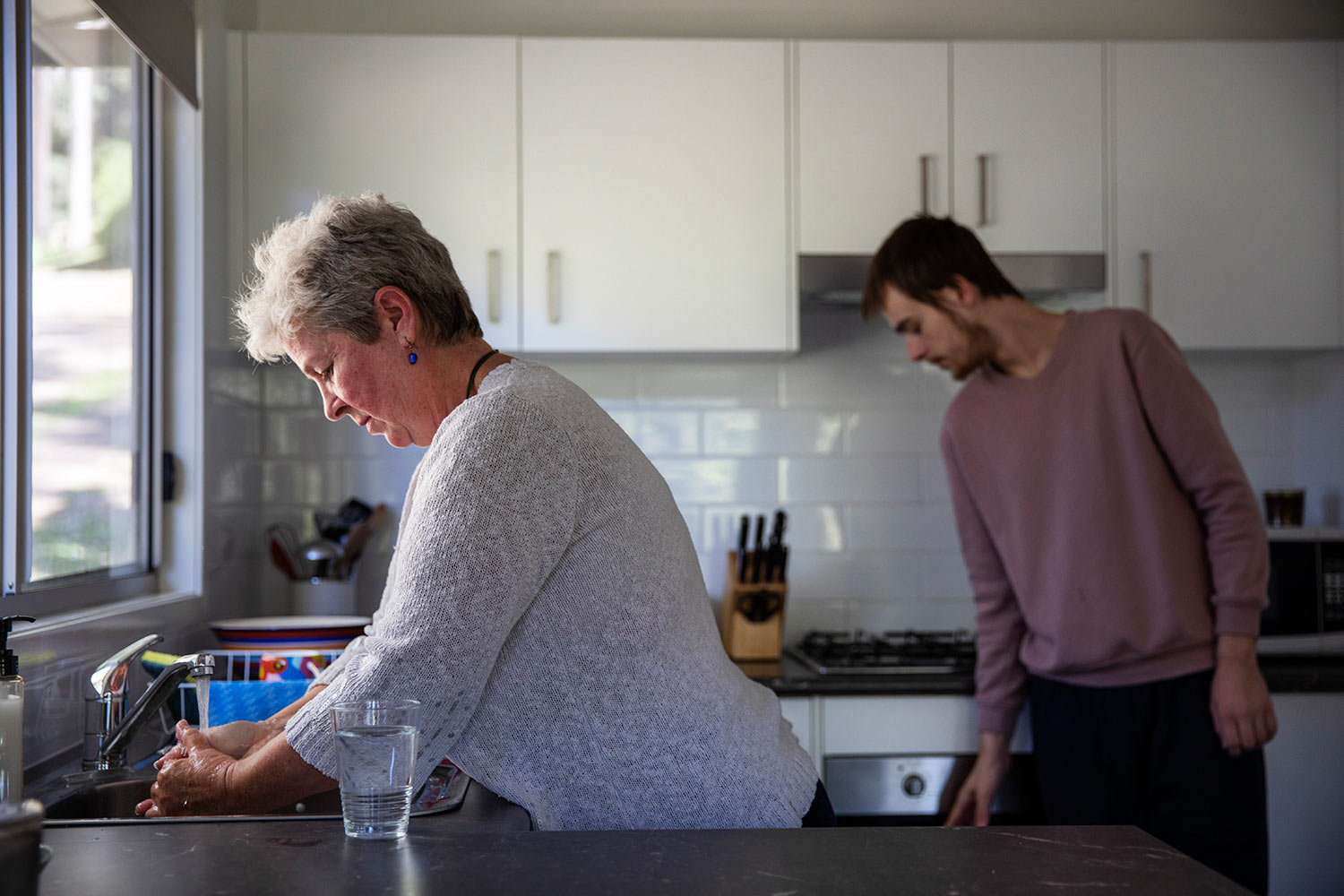 her son, Sam, return to her home for the first time since he last overdosed there three weeks ago, in Fountaindale, Central Coast, Australia, Friday, July 19, 2019. (AP Photo/David Goldman)