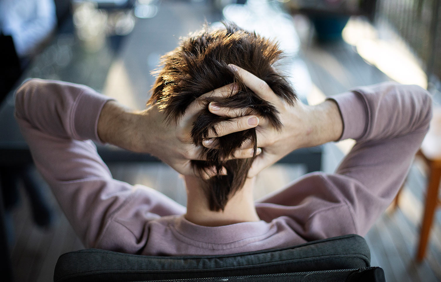 Sam Ware runs his fingers through his hair while listening to his mother urge him to go to rehab, in Fountaindale, Central Coast, Australia, Friday, July 19, 2019. (AP Photo/David Goldman)