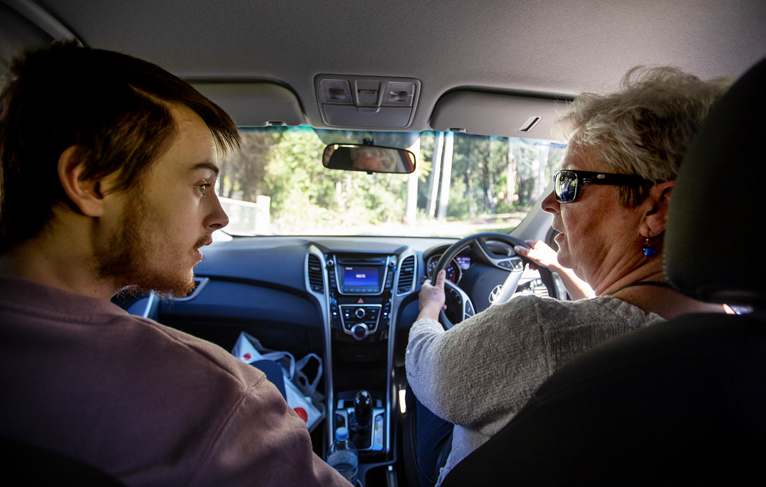 Deb Ware, right, drives her son, Sam, back to her home for the first time since she last found him overdosing there three weeks earlier in Fountaindale, Central Coast, Australia, Friday, July 19, 2019. (AP Photo/David Goldman)