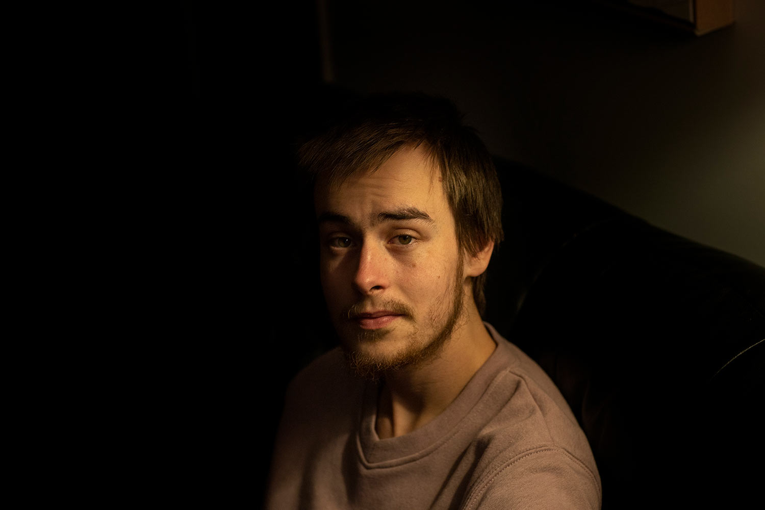 Sam Ware, 22, sits for a photo in his mother's home, in Fountaindale, Central Coast, Australia, Friday, July 19, 2019. (AP Photo/David Goldman)