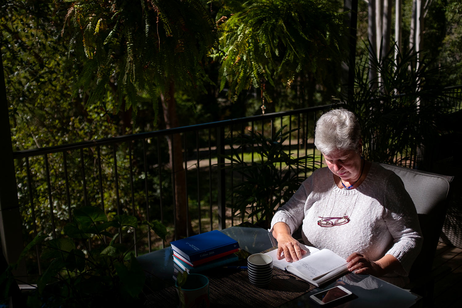Deb Ware logs an entry in her diary at her home in Fountaindale, Central Coast, Australia, Friday, July 19, 2019. (AP Photo/David Goldman)