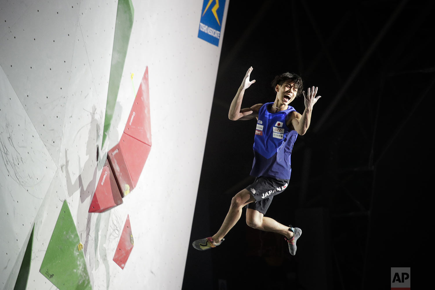 Kai Harada, of Japan, reacts as he falls from a bouldering wall during the men's combined bouldering final at the International Federation of Sport Climbing World Championships, in Tokyo, Wednesday, Aug. 21, 2019. (AP Photo/Jae C. Hong)