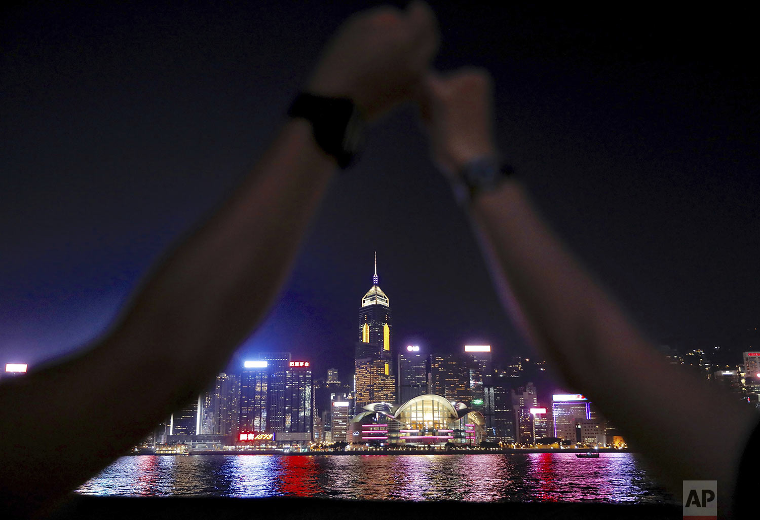 Demonstrators link hands as they gather at the Tsim Sha Tsui waterfront in Hong Kong, Friday, Aug. 23, 2019. (AP Photo/Vincent Yu)