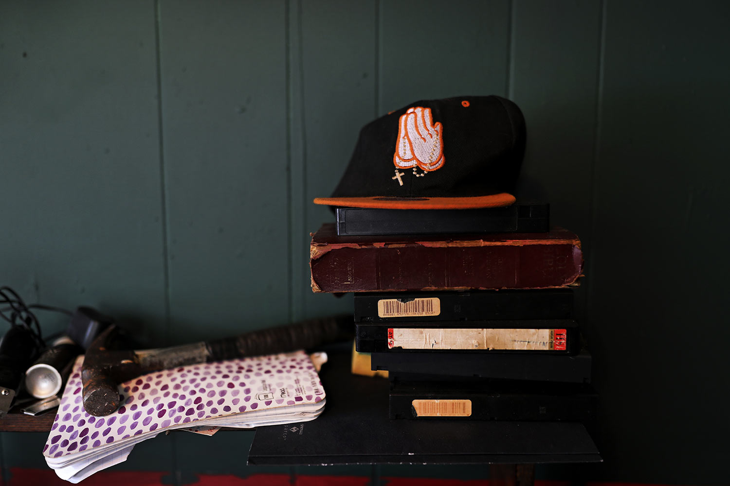 A cap embroidered with prayer hands sits on a shelf in Joshua K. Love's living room at his home in Greenwood, Miss., Saturday, June 8, 2019. Love says he prays and believes in God, even though he was allegedly sexually abused at a local Catholic grade school. (AP Photo/Wong Maye-E)