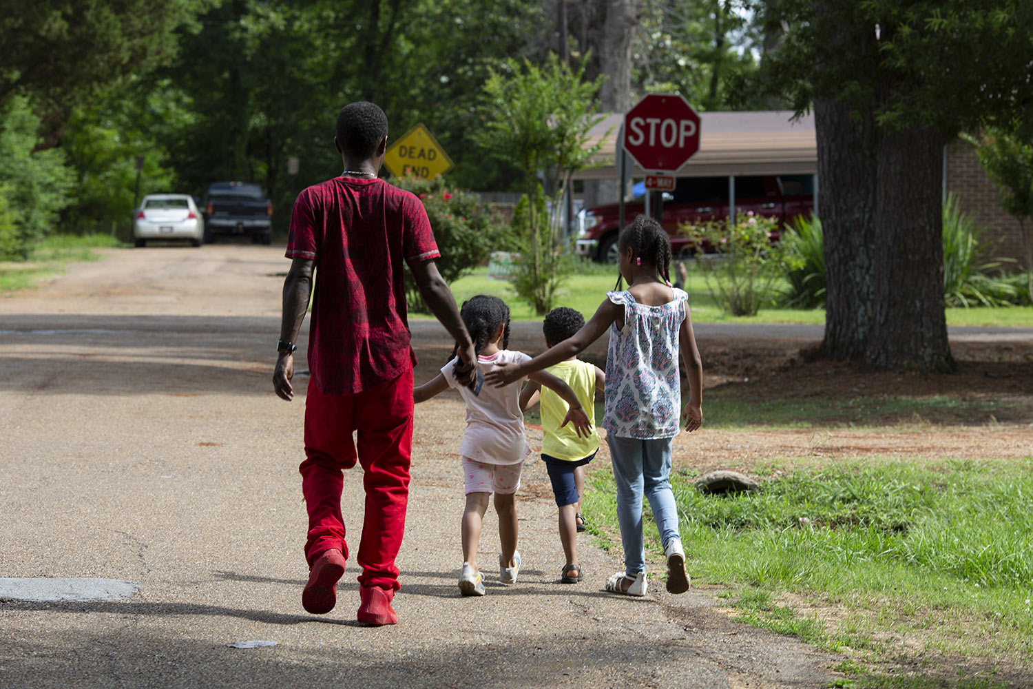 Joshua K. Love walks home with his nieces and nephew after a game of basketball in Greenwood, Miss., Saturday, June 8, 2019. (AP Photo/Wong Maye-E)