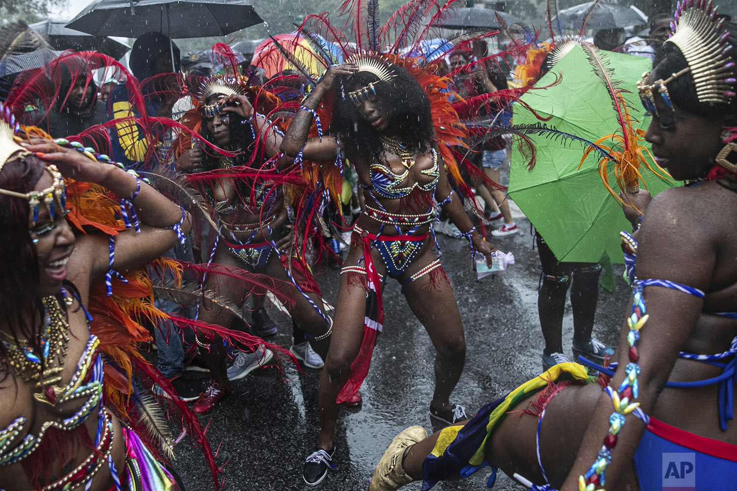 Revelers participate in the West Indian American Day Parade in the Brooklyn borough of New York, Monday, Sept. 2, 2019 (AP Photo/Jeenah Moon)