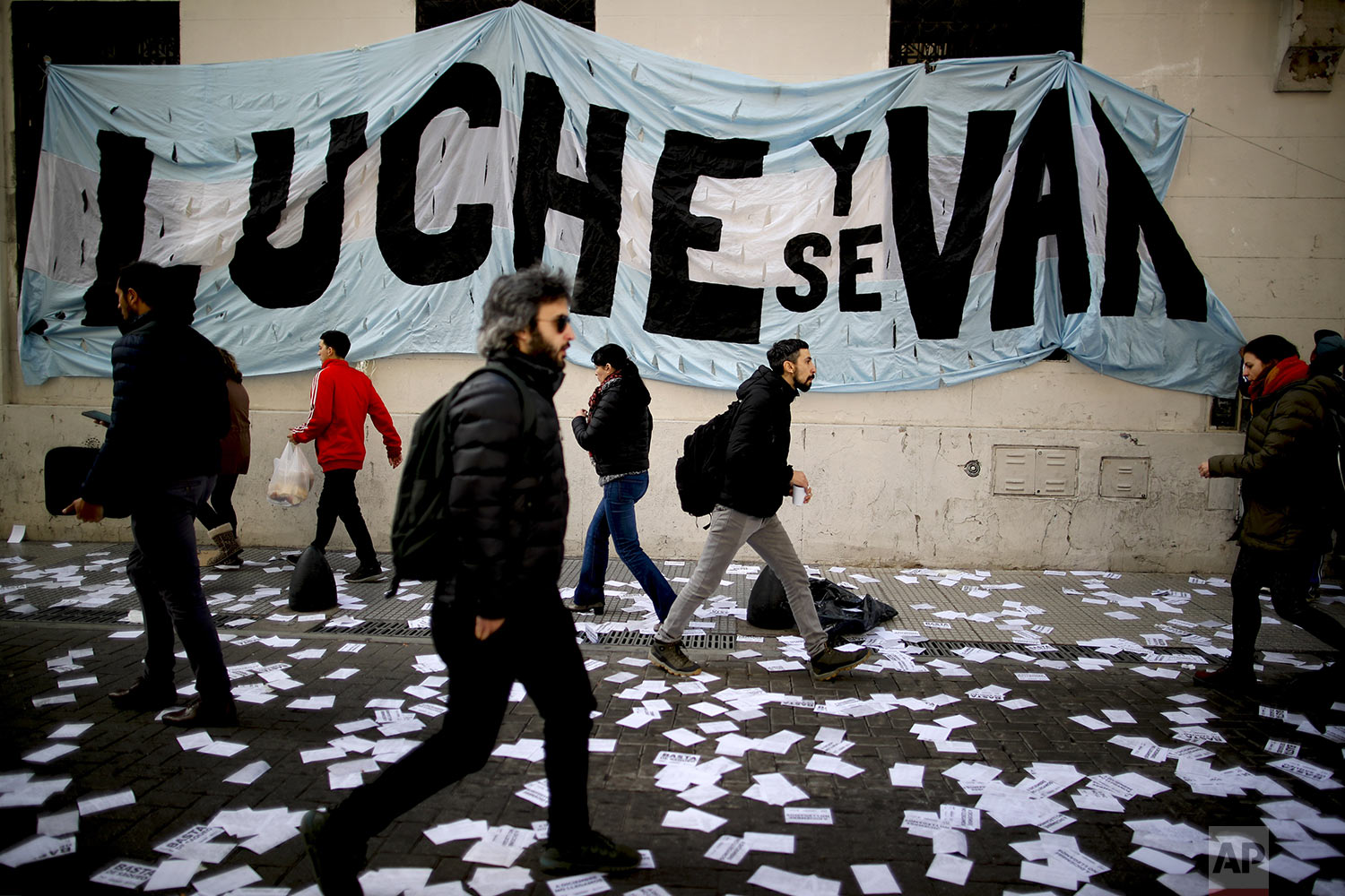 "A banner with a message that reads in Spanish: ""Fight and they will leave"" in reference to President Mauricio Macri and his administration, hangs from a facade of the Central Bank during a demonstration in Buenos Aires, Argentina, Wednesday, Sept. 4, 2019. (AP Photo/Natacha Pisarenko)"
