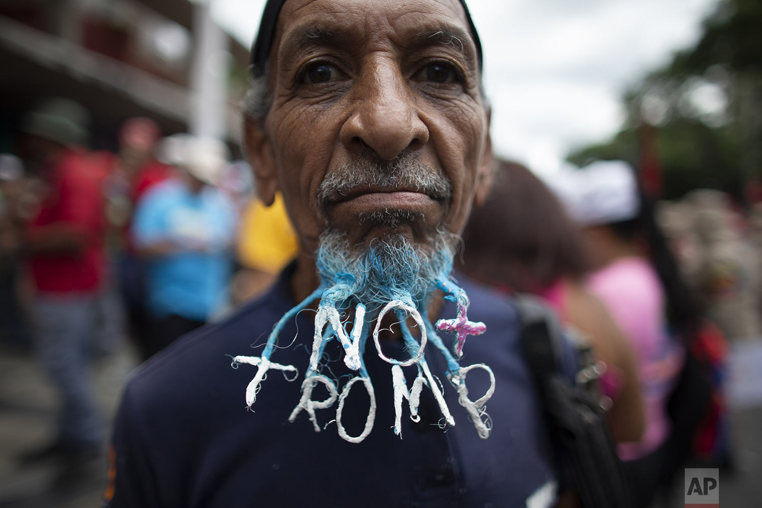 "A supporter of President Nicolas Maduro dons a beard woven into a message that reads in Spanish; ""No more Trump"" during an anti-imperialist rally in Caracas, Venezuela, Saturday, Aug. 31, 2019. U.S.-based Mastercard suspended its services to two Venezuelan banks under sanctions aimed at forcing Maduro from power in the crisis-stricken South American nation. (AP Photo/Ariana Cubillos)"