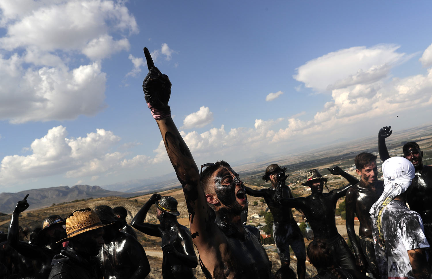 Bboys painted with black grease celebrate during the traditional festivities of the Cascamorras festival in Baza, Spain, Friday, Sept. 6, 2019. (AP Photo/Manu Fernandez)