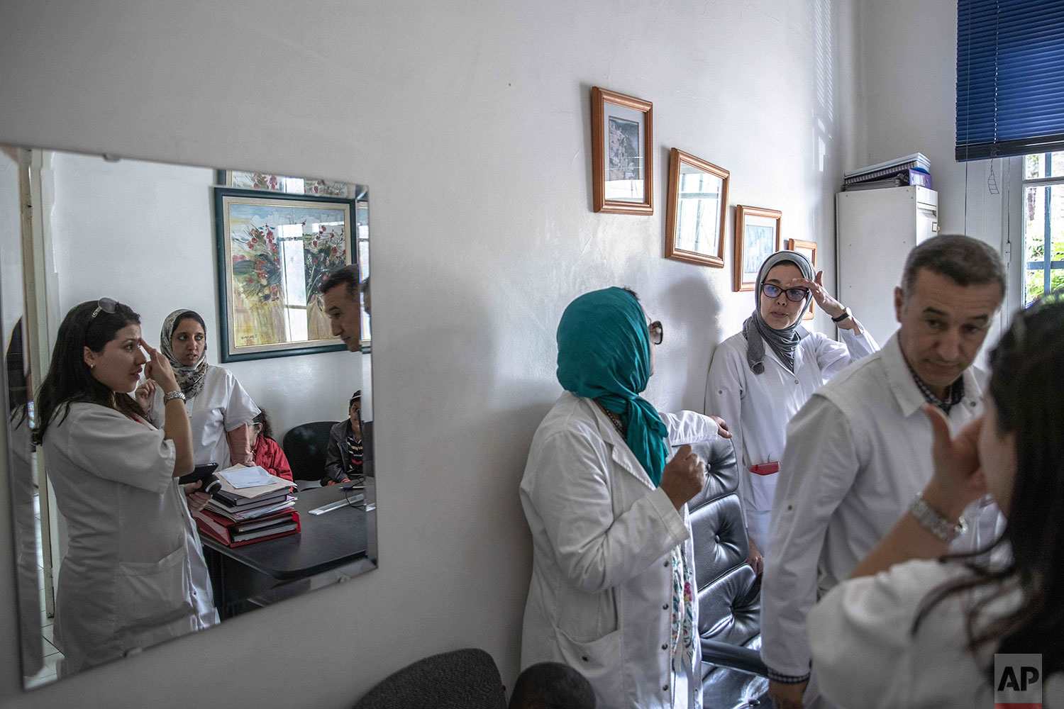 In this Wednesday, July 24, 2019 photo, dermatologists gather information on children affected by a rare disorder called xeroderma pigmentosum, or XP, inside a hospital in Casablanca, Morocco. (AP Photo/Mosa'ab Elshamy)