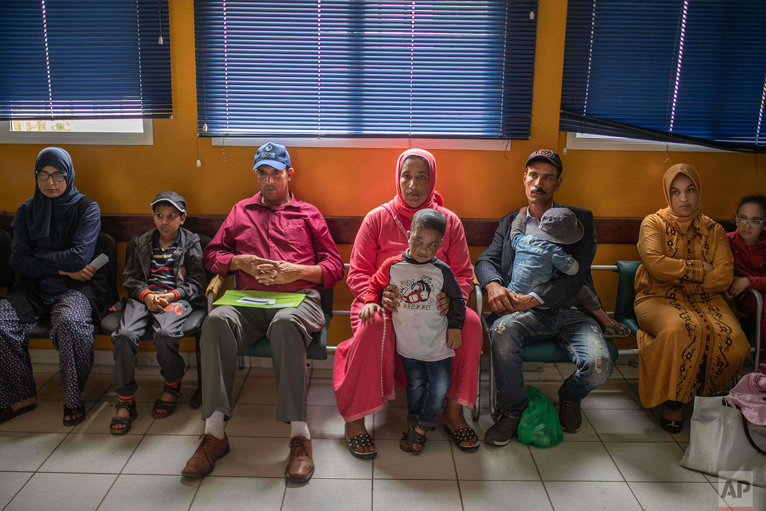 In this Wednesday, July 24, 2019 photo, families wait alongside their children affected by a rare disorder called xeroderma pigmentosum, or XP, inside a hospital in Casablanca, Morocco. (AP Photo/Mosa'ab Elshamy)