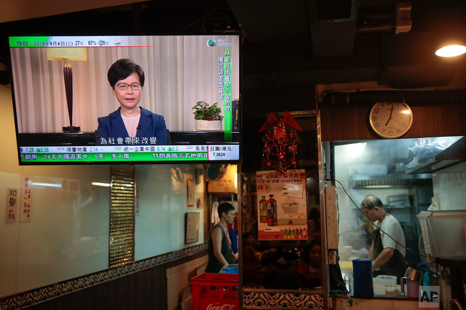Hong Kong Chief Executive Carrie Lam makes an announcement on an extradition bill in television message, seen at a restaurant in Hong Kong, Sept. 4, 2019. (AP Photo/Jae C. Hong)