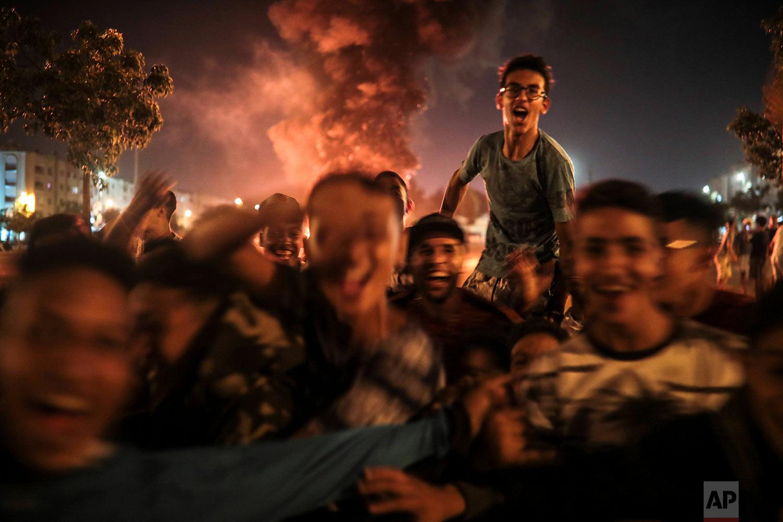 Youths react during the celebration of Ashura, in Sale, near Rabat, Morocco, Sept. 9, 2019. (AP Photo/Mosa'ab Elshamy)