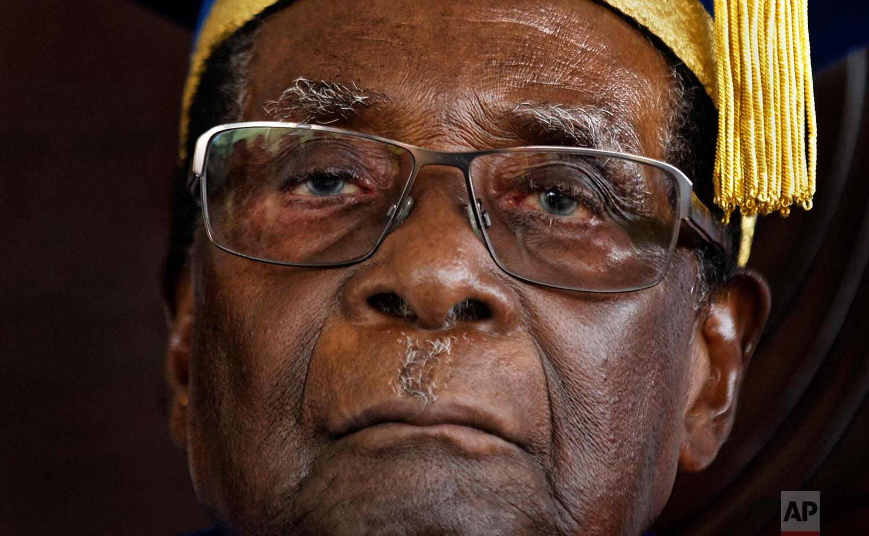 Zimbabwe's President Robert Mugabe officiates at a graduation ceremony at Zimbabwe Open University in Harare, Zimbabwe, Nov. 17, 2017. (AP Photo/Ben Curtis)