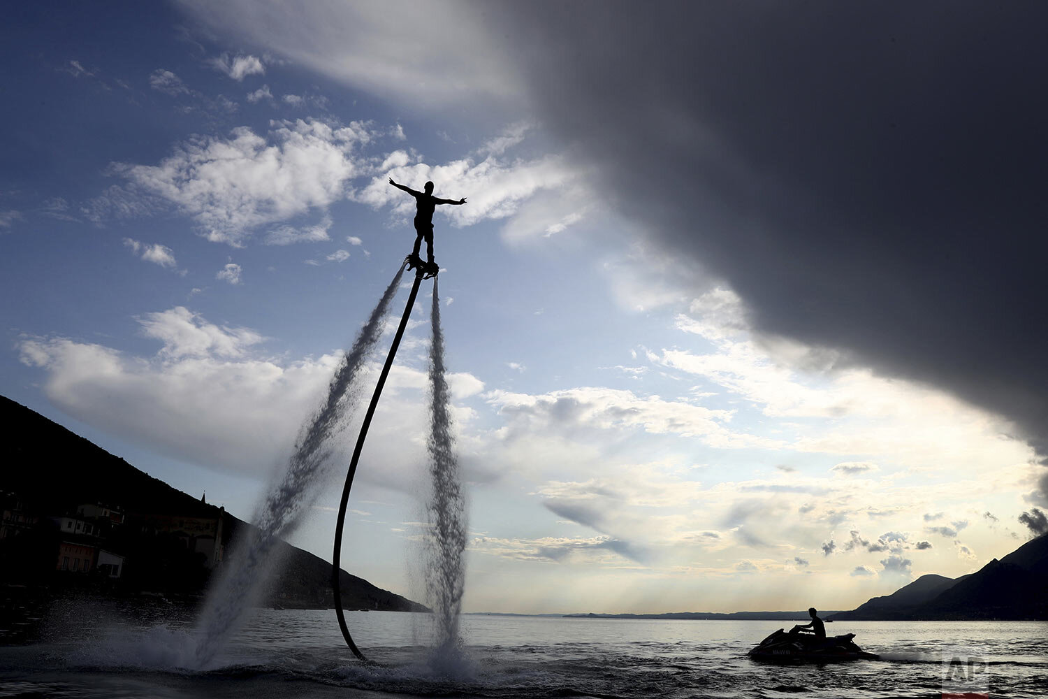 A man rides his flyboard at the Garda lake in Brenzone, northern Italy, Saturday, Sept. 7, 2019. (AP Photo/Matthias Schrader)
