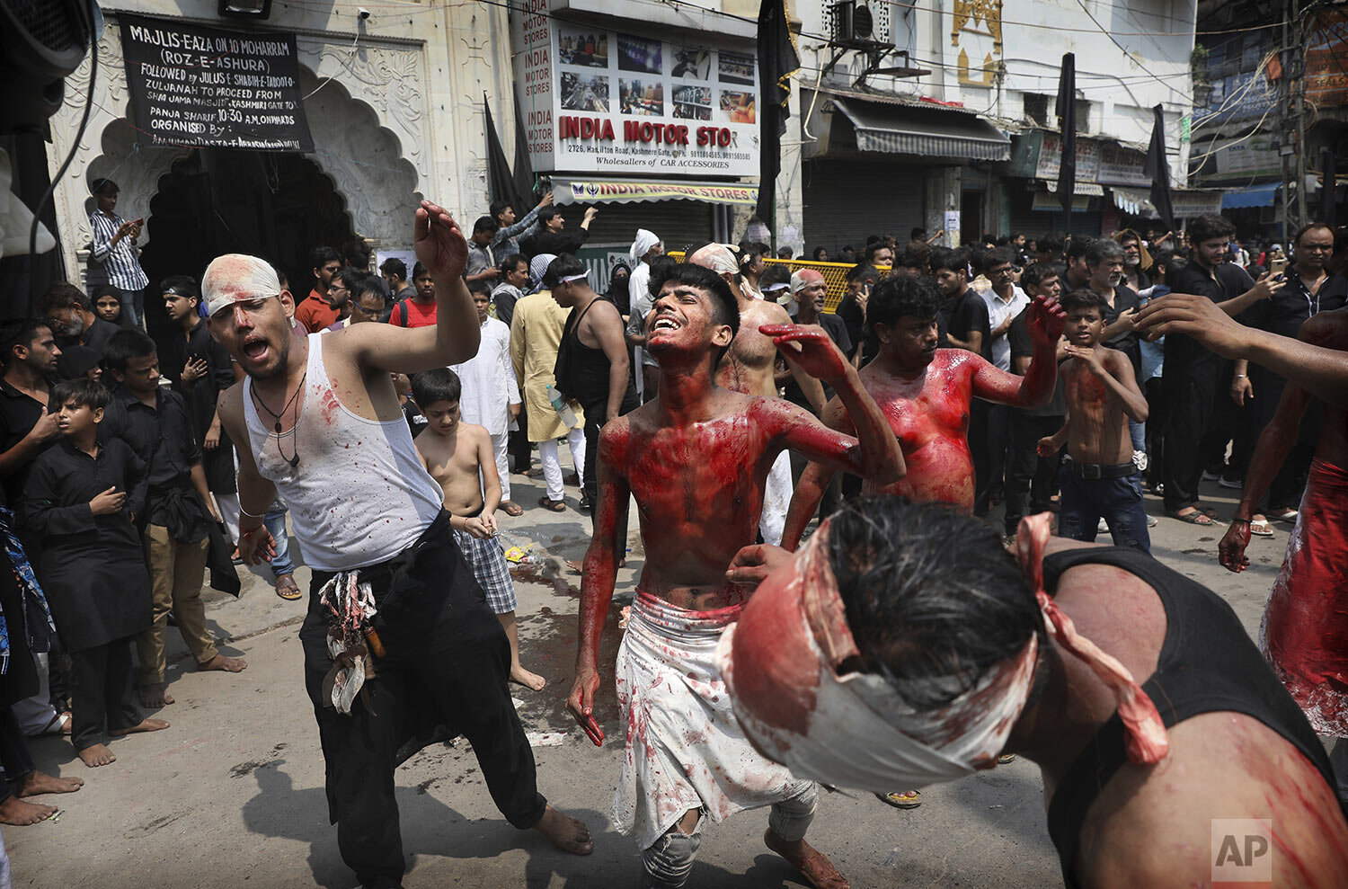 Indian Shiite Muslims flagellate themselves with chained knives during an Ashoura procession in New Delhi, India, Tuesday, Sept. 10, 2019. Shiites mark Ashoura, the tenth day of the month of Muharram, to commemorate the martyrdom of Imam Hussein, a grandson of Prophet Muhammad, during the Battle of Karbala.  (AP Photo/Manish Swarup)