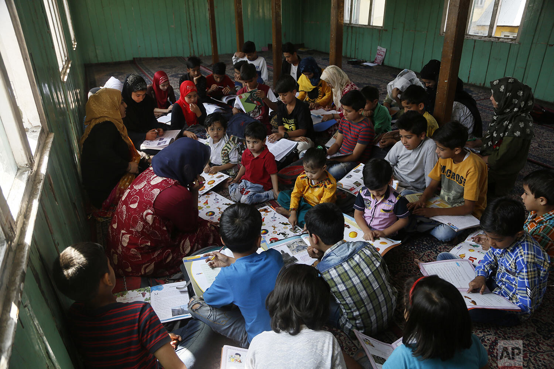 Children study inside a local mosque building during a free class by locals in Srinagar, Indian controlled Kashmir, Thursday, Sept. 19, 2019. (AP Photo/Mukhtar Khan)
