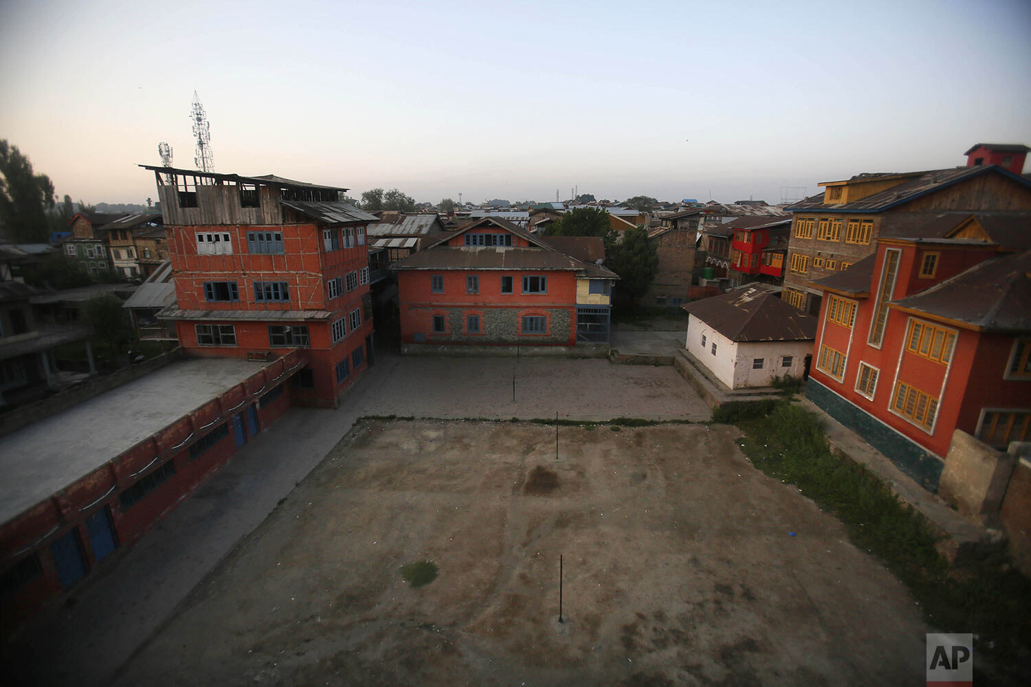 A school building stands isolated during a strike in Srinagar, Indian controlled Kashmir, Thursday, Sept. 12, 2019. (AP Photo/Mukhtar Khan)